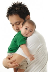 Asian Chinese father with baby